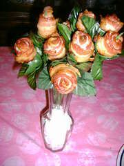 Bacon Roses.!!  No Water needed   I can't kill these.  But I Can Eat Them Up !   I made cups out of tin foil and put them in the cupcake pans. Poked holes in the bottom,