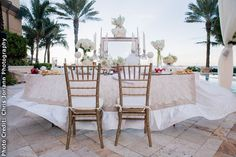 The sweetheart table facing the spectacular ocean view. Venue: Eau Palm Beach Resort & Spa in Manapalan, FL. Photo: Chris Joriann Photography