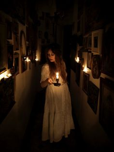 Long narrow hall with tons of photos and candles Story Inspiration, Writing Inspiration, Character Inspiration, Maleficarum, Lady Macbeth, Southern Gothic, Petticoats, Macabre, Vampires