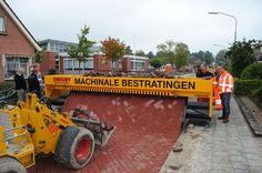 Tiger-Stone: This ingenious Dutch machine lays brick roads by an angled plane which is fed with bricks which are packed together by gravity as the crawler moves forward on the sand base.