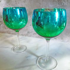 Available as gin glasses, martini glasses and champagne saucers, these gorgeous pieces have a peacock feather design on the exterior of the glass and the graduated colour goes from an emerald green to a rich turquoise. Champagne Saucers, Gin Glasses, Kitchen Dinning, Feather Design, Metallic Blue, Aga, Emerald Green, Martini, Home Accessories