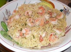 Linguini Alfredo With Shrimp. YUMMY!!   								My husband loves this recipe. Not very figure friendly, but good.