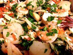 Seafood salad with tomato, fennel, parsley, lemon, limoncello liqueur.