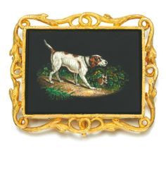 Gold micro-mosaic brooch, 1850s.   Centring on a rectangular plaque depicting a micro-mosaic of a spaniel, within a gold entwined branch frame, fitted case stamped Morel & Co. Via Sotheby's.