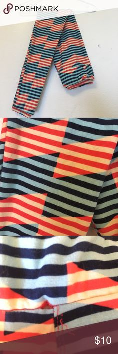 LuLaRoe OS leggings Red, dark blue, light blue and cream striped leggings! Fun design! Only worn once! 💥Damaged; machine stitch error! Pictured. Reflected in price.💥 would be really simple to fix I just don't have the time! 😅 LuLaRoe Pants Leggings