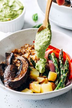 Roasted Mushroom Vegetable Bowls with Avocado Pistachio Pesto- portobello mushrooms and spring vegetables are roasted in one-pan and topped with a creamy avocado pistachio pesto. Super easy, flavorful and satisfying! (vegan with gluten-free option)