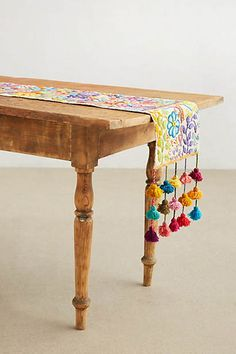 This table runner is so fun and gorgeous!  Great for summer entertaining.  Tassel Stitch Table Runner #Anthropologie #PinToWin