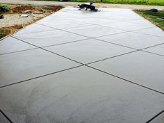 For years, We Do Concrete Cheap has been providing the highest quality concrete driveway installation services in the Raleigh Durham Triangle Area. Cement Driveway, Stamped Concrete Driveway, Asphalt Driveway, Driveway Design, Front Yard Design, Driveway Landscaping, Modern Landscaping, Driveway Ideas, Circle Driveway