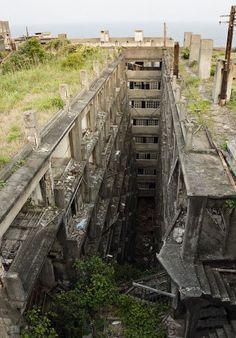 Hashima Island also called Battleship Island is an abandoned coal mining facility and city off the coast of Japan near Nagasaki. Abandoned Buildings, Abandoned Mansions, Old Buildings, Abandoned Places In The Uk, Hashima Island, Places Around The World, Around The Worlds, Chernobyl, Haunted Places