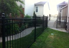 Black Iron fence with custom interlock pathway. Completed for a customer in Barrhaven, Ottawa.