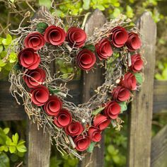 Use a pre-made straw or branch wreath form; add rolled paper or felt roses.