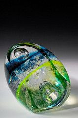 The Organisms are creatures forever captured in glass. Their form is simple and modernist, but the inner structure is complicated and organic. The reflective and refractive qualities of glass create an added dimension to these works.