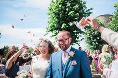 Framlingham summer wedding. Fun rose petal confetti photo!
