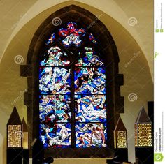 Photo about The beautiful complex stained glass windows in the Chappell of the Abbey of St. Maurice, Agaunum in Valais Switzerland with an archway. Image of windows, switzerland, chapel - 105721819