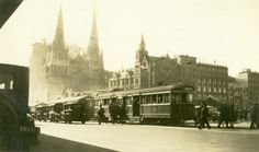 A traffic scene in Swanston St [Melbourne, Vic. 1925 - ca. This view from Flinders Street Station shows the Cathedral spires still under construction. Trams have run past the Cathedral along busy Swanston Street since Melbourne Tram, Melbourne Suburbs, Melbourne Victoria, Victoria Australia, Australian Continent, Bonde, Largest Countries, New City, Historical Pictures