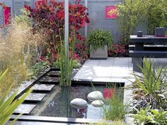 Garden Materials: The shapes and materials in this garden add color and movement that lure the eye toward the garden. (DK - Garden Design
