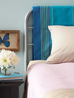 Simple headboard with a pretty piece of material over the metal frame - change it out with moods or seasons!