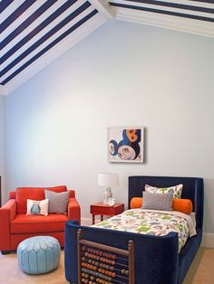 A painted striped ceiling adds a playful element to this kids room.