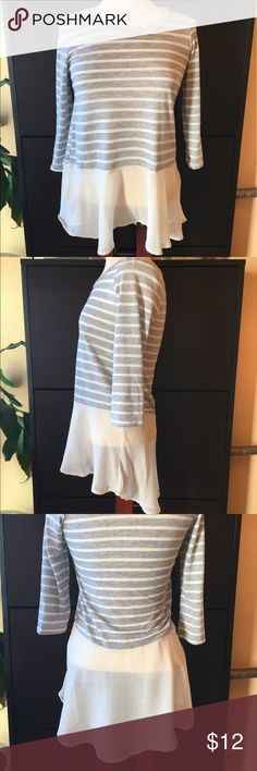 Cute layered look top with chiffon bottom Adorable top with 3/4 length sleeves, gray and white striped and bi level hem. The chiffon layer is so flowy and cute and longer in the back then front. The tag says size small but I would say it's closer to an XS especially in the arms. In great condition. Tops