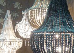 These chic chandeliers fuse the grandeur of statement lighting with the charm of understated beads, which are hand rolled by women suffering from HIV. The result is a unique duet of two aesthetics that carries elegance into any home.