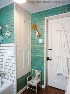 {Primping in the Ladies' Room} This looks like another view of the bathroom with the sheet music wallpaper.