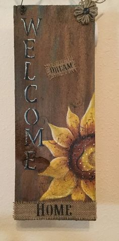 Upcycled wood shingle with hand painted Sunflower and welcome. Comes ready to hang with wire hanger. Measures about 17 x 6.   Welcomeis stenciled in black near top of burlap sack. Comes complete and ready to hang with wire hanger. Thanks for visiting and keep watching for new items.o