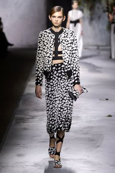 Then Ashkenazi changed directions, going tough with pleated black leather and body harnesses that peeked out from underneath dresses and sporty separates.   - HarpersBAZAAR.com