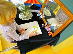 Add a mirror to Reading & Writing Center to encourage self-portraits