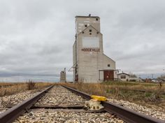 """The village of Hodgeville Saskatchewan has two grain elevators. One is a traditional style wood-cribbed """"prairie sentinel"""" – you know the. Concrete Structure, Building Structure, Landscape Photos, Landscape Paintings, Grain Storage, Building A Tiny House, Old Barns, Old Buildings, Paths"""