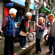 Small and cute old people having a laugh. I wish I could take everyone of them home and fuss over them :)