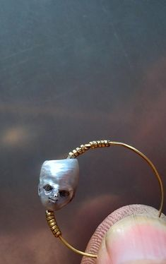 SHINJI NAKABA - pearl boy - carved pearl , steel (gold plated) ,          2013