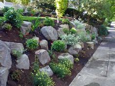 landscaping boulder retaining walls | Boulder settings and retaining wall
