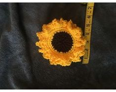 Crocheted sunflower coaster beside measuring tape showing it to be about Crochet Sunflower, Coaster Design, Drink Coasters, Make And Sell, Crafts To Sell, Hand Crochet, Craft Gifts, Tape, Things To Sell