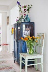 wildflowers. cut flowers display. vintage glass bottles. pastels. distressed wood.