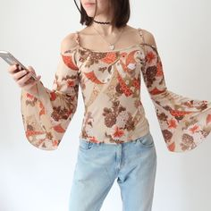 ⭐️✌🏻🌼🌼 Amazing vintage boho hippy off the shoulder flower power top with flared sleeves 🌼🌼✌🏻️⭐️ size stretchy. In Like New condition, no flaws. Instant buy is on! Hippy, Hippie Boho, Flower Power, Off The Shoulder, Long Sleeve Tops, Floral Tops, Flaws, Amazing, Unique
