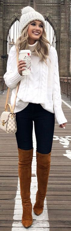 #winter #outfits white knitted jacket and blue pants with brown thigh-high boots and hat #JacketsForWomenWinter