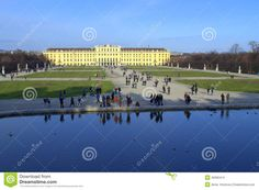 People sightseeing at beautiful winter day  in Schonbrunn Palace garden and pond in Vienna, Austria