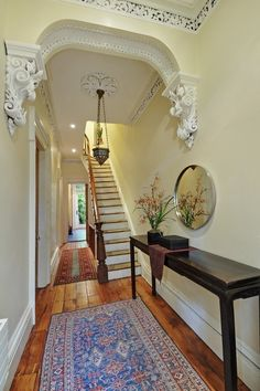 Victorian Gothic interior style 1859 Brooklyn brownstone Victorian foyer interior enriched corbels crown molding