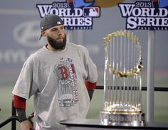 The Boston Red Sox win the World Series  --  MLB: World Series-St. Louis Cardinals at Boston Red Sox -- Oct 30, 2013; Boston, MA, USA; Boston Red Sox second baseman Dustin Pedroia stands next to the World Series championship trophy after game six of the MLB baseball World Series against the St. Louis Cardinals at Fenway Park. The Red Sox won 6-1 to win the series four games to two. (Robert Deutsch-USA TODAY Sports)
