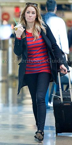 Lauren Conrad wore a cute Enza Costa Thin Stripe Sweater while catching a departing flight out of LAX Airport February 2, 2012
