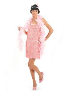Disfraz rosa de los años 20 para mujer: Precioso disfraz retro para mujer compuesto por un bonito vestido color rosa caramelo. Lleva flecos en la parte delantera que se moverán al ritmo de tus pasos. Incluye una cinta para el pelo a...