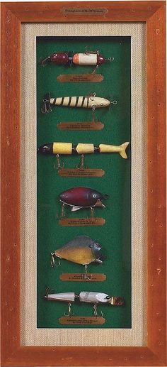 For the tackle obsessed fisherman. Anglers will love this modern version of our antique barnwood shadowbox. Features lures from the 20th century in a beautifully detailed shadowbox set against green c