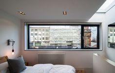 Large horizontal bedroom window and roof light with minimal artificial lighting in the converted loft bedroom. Basement Bedrooms, Bedroom Loft, Large Bedroom, Trendy Bedroom, Interior Windows, Bedroom Windows, Modern Bedroom Furniture, Contemporary Bedroom, Loft Conversion Windows