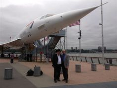 Fred Finn and Tom Stuker stand in front of a British Airways Concorde jet at the Intrepid Sea, Air & Space Museum on Wednesday in New York C...