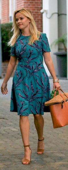 Who made Reese Witherspoon's blue floral print dress and brown suede sandals?