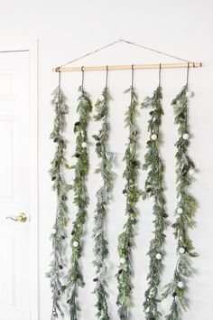 Simple holiday garland backdrop. Perfect as a photobooth backdrop or behind a dessert table.