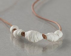 White Coral Reef - Porcelain beads and natural brown leather necklace. Designed and crafted by Wapa Studio. $40.00, via Etsy.