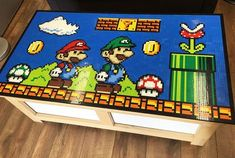 Our Lego Super Mario Bros table top collage is complete! We designed and created a Super Mario scene completely out of Lego for our design studio Lego Mario, Lego Super Mario, Mosaico Lego, Deco Lego, Super Mario Room, 8bit Art, Lego Table, Video Game Rooms, Lego Room