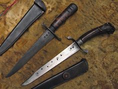 Knives by John (top) and Hershel (bottom) House with sheaths by John House.