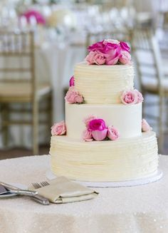 Featured Photographer: Emilia Jane Photography; Elegant three tier white wedding cake topped with pink roses